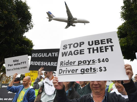 Rideshare drivers for Uber and Lyft stage a strike and protest at the LAX International Airport, over what they say are unfair wages in Los Angeles, California on May 8, 2019. Mark Mix writes that workers should be allowed, but not compelled, to join unions and pay dues.