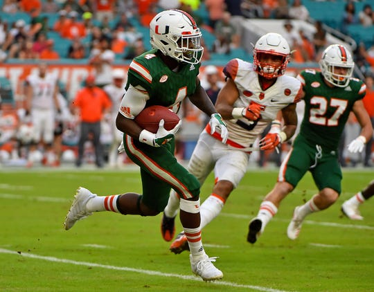 Miami wide receiver Jeff Thomas returns a kickoff against Syracuse during their game in 2017.