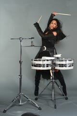 With her signature stilettos, Sheila E. has been called one of the greatest female drummers of all time.