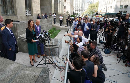 Harvey Weinstein's lawyers, including Donna Rotunno (C).  talk to reporters after his hearing July 11, 2019.