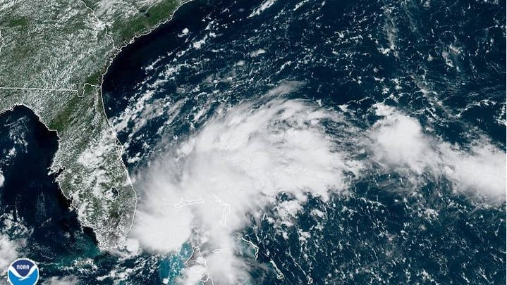 A satellite image from Friday morning, August 23, 2019, shows a tropical disturbance spinning east of Florida.