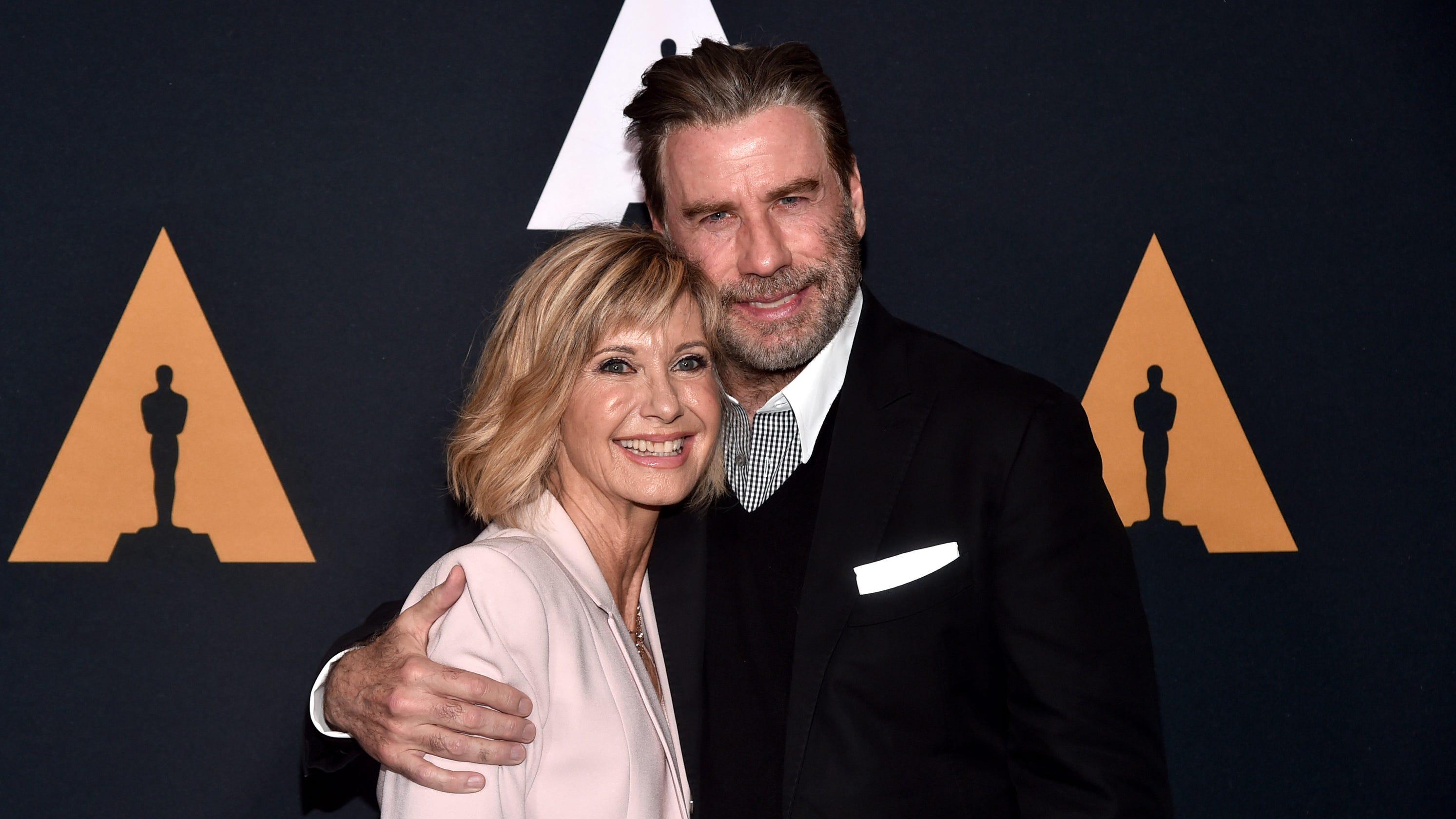 John Travolta is 'very proud' of Olivia Newton-John as she battles cancer for third time