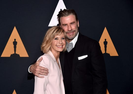 John Travolta is 'very proud' of Olivia Newton-John as she battles cancer for third time