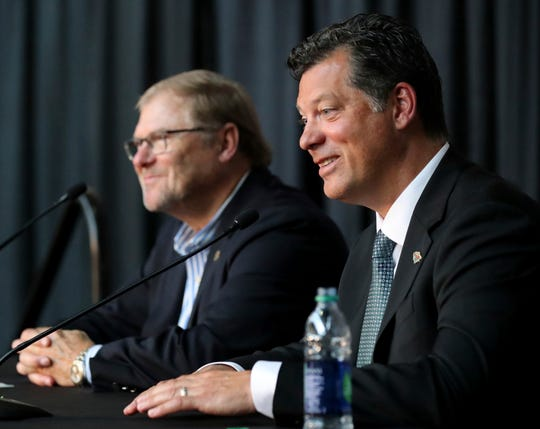 Minnesota Wild owner Craig Leipold, left, smiles with new general manager Bill Guerin at a news conference.