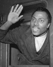 Singer Little Richard waves goodbye from the United States boat train at Waterloo Station in Canada on Nov. 20, 1963, on his way back to America.  He is to become a minister of the Seventh Day Adventists early in the new year.