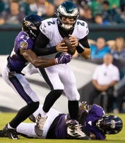 Eagles QB Cody Kessler is sacked by the Ravens' Brandon Carr.