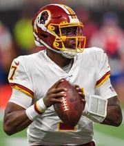 Redskins quarterback Dwayne Haskins runs from the pocket against the Falcons.