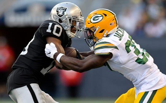 Raiders wide receiver Rico Gafford rushes against Packers cornerback Josh Jackson.