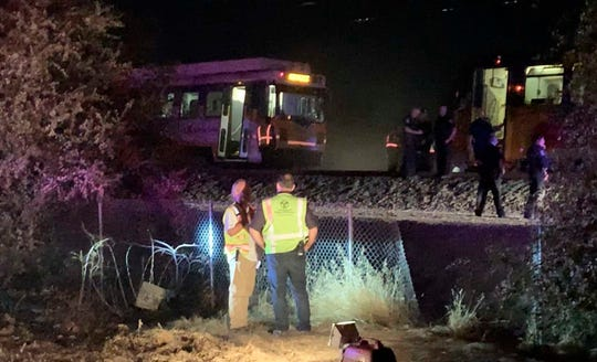 In this image made from video, a Sacramento Regional Transit light-rail car is seen stopped in Sacramento, California, on Thursday, Aug. 22, 2019.  Authorities say more than two dozen people have been injured in a light rail train derailment in Northern California.