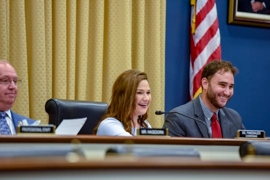 Rep. Abby Finkenauer, as chair of the RATE Subcommittee, jokes with a farmer testifying at her hearing