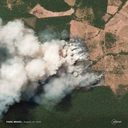 This handout picture collected by a satellite of © 2019 Planet Labs, Inc on August 20, 2019 shows smoke and fires in Brazil's state Para.