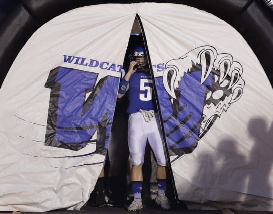 Oshkosh West High School's #5 Nate Carlin waits to take the field against Kimberly High School before during their football game at Titan Stadium on Friday, August 23, 2019, in Oshkosh, Wis. Kimberly defeated Oshkosh West 31-12.
