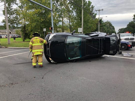A Lexus flipped over after being involved in a collision on Rt. 70 in Manchester on Friday.