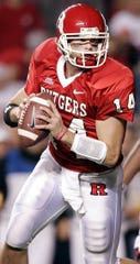 Rutgers' quarterback Mike Teel (14) rolls out against Louisville on  Thursday, Nov. 9, 2006 in Piscataway, N.J.  Rutgers won, 28 -25.