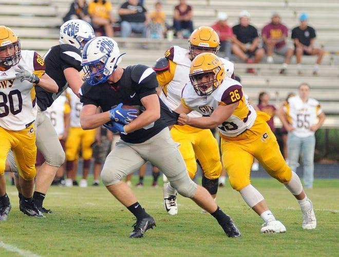 Polk County's Lukas Tipton tries to pull away from Cherokee's Thomas Pheasant