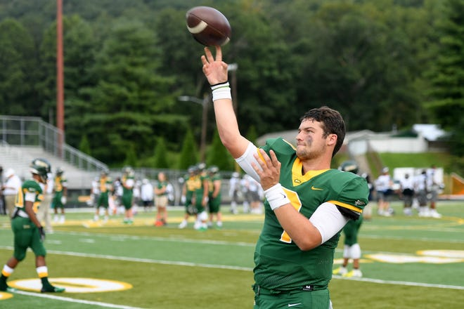 Reynolds quarterback Eli Carr warms up before the Rockets' season opening game against East Forsyth at Reynolds High School on Aug. 23, 2019.