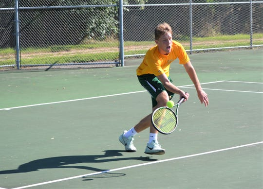 Pennfield No. 1 singles player Cam Reichel hits a return during the All-City Tennis Tournament on Saturday.