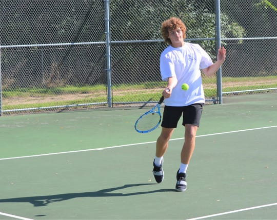 Harper Creek No. 1 singles player Jackson Wilcox competes at the All-City Tennis Tournament Saturday at Pennfield