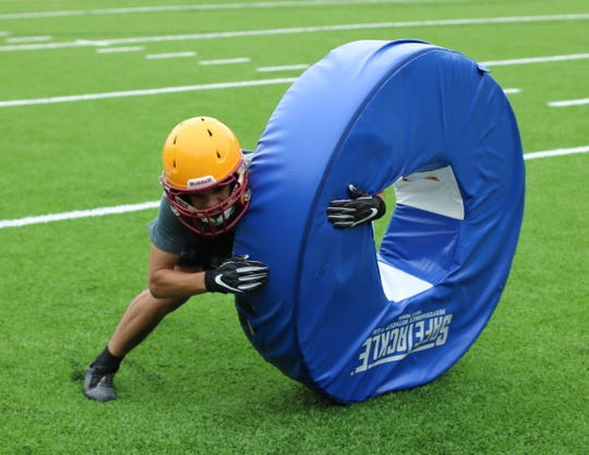 Kingston's Kyler Coe-Yarr practices his tackling form during practice on Aug. 23.
