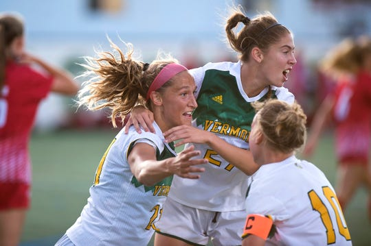 Vermont's Natalie Durieux, left, celebrates her goal with Frances O'Donnell and Ella Bankert during the Catamounts' game against Sacred Heart at Virtue Field on Friday night, Aug. 23, 2019.