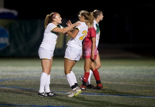 Vermont's Angie Salvi, left, celebrates with Natalie Durieux after the Catamounts' game against Sacred Heart at Virtue Field on Friday night, Aug. 23, 2019.