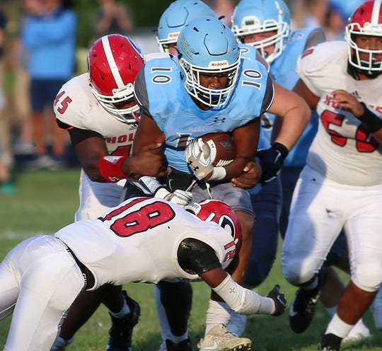 Boone County running back Abdoulaye Ba runs the ball during the Rebels football game against Holmes, Friday, Aug. 23,2019.