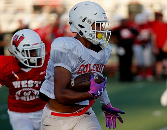 Deshawn Pace carries the ball for Colerain during their scrimmage against Lakota West in West Chester Twp. Friday, August 23, 2019.