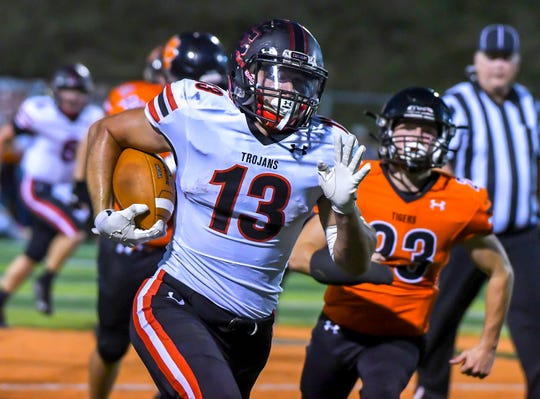 East Central running back Jake Fike runs for a Trojans touchdown at the Skyline Chili Crosstown Showdown, Friday August 23, 2019, Lawrenceburg, Indiana.