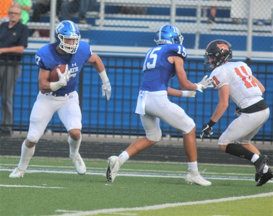 CovCath senior Michael Mayer looks for an opening as he runs downfield for a 76-yard touchdown catch as Covington Catholic defeated Ryle 37-0 August 23, 2019 at Covington Catholic HS.