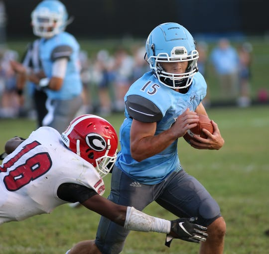 Boone County running back Eli Rossi (15) runs the ball during the Rebels football game against Holmes, Friday, Aug. 23, 2019.