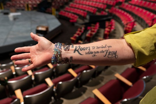Production Manager Veronica Bishop shows a tattoo she got with her daughter at the Cincinnati Playhouse in the Park on Friday, Aug. 23, 2019 in Cincinnati, Ohio.