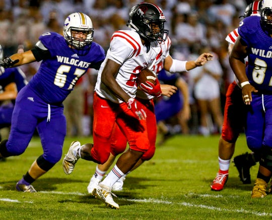 Rossview's Divonte Phillips (28) looks for a hole to run through in Clarksville's defense during a TSSAA football game between Clarksville and Rossview at Clarksville High School in Clarksville, Tenn., on Friday, Aug. 23, 2019.