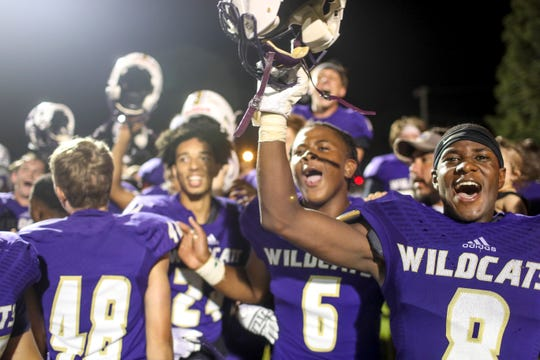Clarksville wide receiver Michael Kennedy (8), right, and other players react to seeing the reveal of the Warfield Shield, a trophy won in the rival game during a TSSAA football game between Clarksville and Rossview at Clarksville High School in Clarksville, Tenn., on Friday, Aug. 23, 2019.