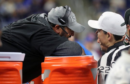 Lions coach Matt Patricia talks with an official after a pass interference call during the first half against the Bills, Aug. 23, 2019 at Ford Field.