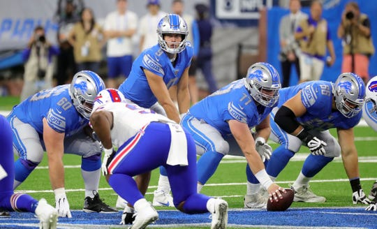 Detroit Lions' Matthew Stafford takes the handoff from center Frank Ragnow during the first half against the Buffalo Bills, Friday, Aug. 23, 2019 at Ford Field.