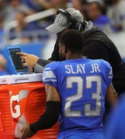 Matt Patricia talks with Darius Slay during the game against Buffalo.