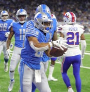 Detroit Lions' Ty Johnson celebrates his touchdown catch against the Buffalo Bills during the first half Friday, Aug. 23, 2019 at Ford Field.