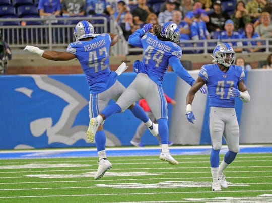 Jalen Reeves-Maybin (44) celebrates with Devon Kennard (42) and Tracy Walker (47) during action against the Bills.