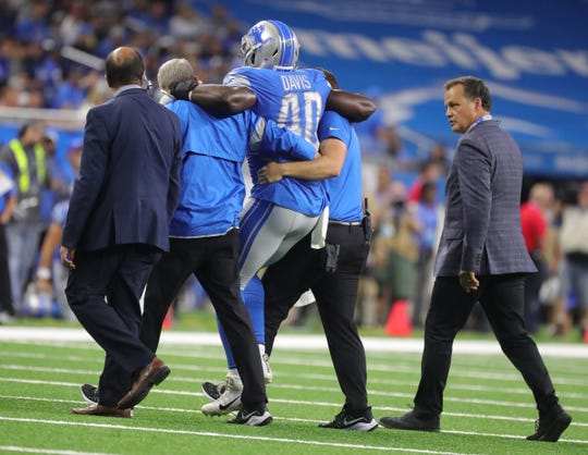 Detroit Lions' Jarrad Davis is helped off the field during the first half against the Buffalo Bills, Friday, Aug. 23, 2019 at Ford Field.