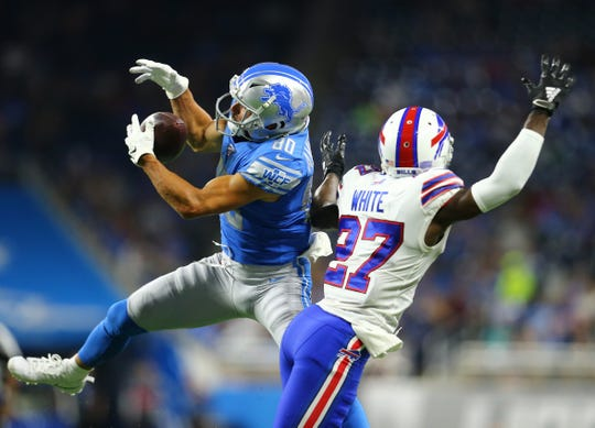 Detroit Lions' Danny Amendola makes a catch in front of the Buffalo Bills' Tre'Davious White in the first quarter during the preseason game at Ford Field on Aug. 23, 2019.