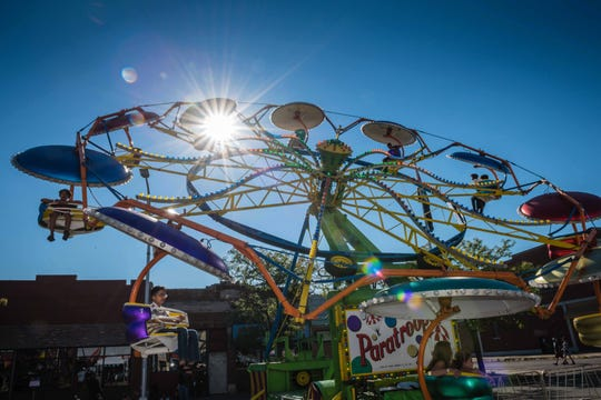 A midway with carnival rides keeps kiddies entertained at the Hamtramck Labor Day Festival.