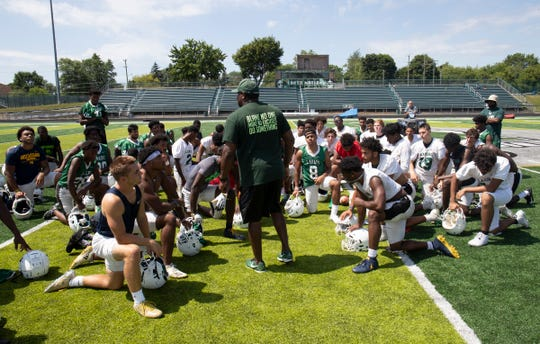 West Bloomfield head coach Ron Bellamy talks to his players on Aug.14, 2019.