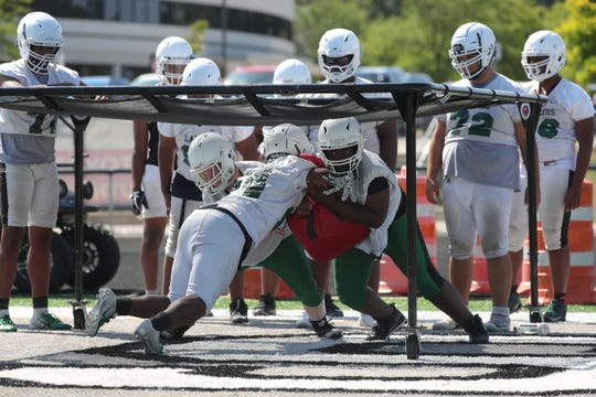 West Bloomfield high school linemen go through drills during practice for the upcoming season on Aug. 14, 2019.