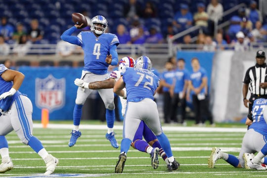 Detroit Lions quarterback Josh Johnson makes a jumping throw against the Buffalo Bills during the fourth quarter Aug. 23, 2019 at Ford Field.