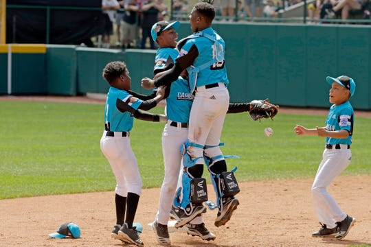 Curacao teammates celebrate after catching the final out of a 5-4 win over Japan in the International Championship game Saturday at the Little League World Series tournament in South Williamsport, Pa.