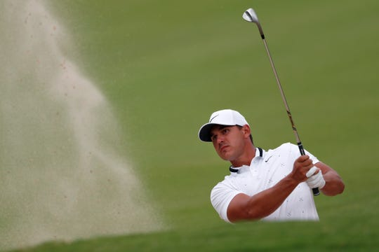 Brooks Koepka hits out of a fairway bunker on the 13th hole during second round of the Tour Championship on Friday.