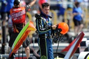 Hydroplane driver Andrew Tate takes his helmet off following a second place finish in a Grand Prix heat Saturday during Detroit Hydrofest.