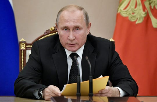 Russian President Vladimir Putin speaks at a meeting with members of the Security Council in the Kremlin in Moscow, Russia, Friday, Aug. 23, 2019. Putin ordered the Russian military to ponder a quid pro quo response after Sunday's test of a new U.S. missile banned under a now-defunct arms treaty.