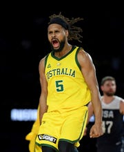Australia's Patty Mills makes a 3-pointer during the win over Team USA.