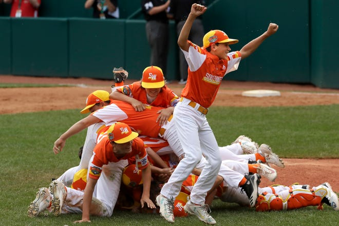 River Ridge, Louisiana's Peyton Spadoni, center, and teammates celebrate a 9-5 win in the United State Championship baseball game over Wailuku, Hawaii on Saturday at the Little League World Series tournament in South Williamsport, Pa. Louisiana will play Curacao in Sunday's Little League World Series Championship game.